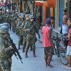 PM militarized police personnel in combat gear deploy at Rocinha favela in Rio de Janeiro, Brazil on September 23, 2017.  Although shooting was reported in the early hours of Saturday in Rocinha -- for the seventh day running -- officials said that Friday's deployment of 950 soldiers to reinforce police had brought the crisis under control. / AFP PHOTO / CARL DE SOUZA