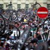 Hungarian cyclists hold up their bikes a