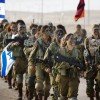 Female soldiers of Israel's 33rd Caracal Battalion take part in a graduation march in the northern part of the southern Israeli Negev desert on March 13. The Caracal was formed in 2004 with the chief purpose of giving women a chance to serve in a true combat role.