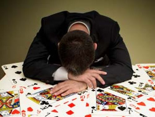 Businessman at Card Table