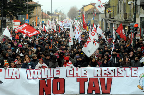 "** CORRECTS IN THE FIRST SENTENCE RESTING TO RESISTING ** Protesters hold a banner reading, NO TAV(No to high speed train) the resisting valley, during a demonstration in Susa, near Turin, northern Italy, Saturday, Jan. 23, 2010. Demonstrators are protesting against the proposed plans to build the Turin-Lyon high-speed train line including a tunnel in the Italian ""Val di Susa"" valley. (AP Photo/Massimo Pinca)"