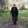 Emilia Kamvisi, an 85-year-old grandmother, is seen outside her home in the Greek island of Lesbos February 1, 2016 after she was nominated for the Nobel Peace Prize. Kamvisi's flash of fame came after she and two friends aged 89 and 85 were photographed bottlefeeding a Syrian baby last autumn, as they helped refugees who had survived the treacherous boat journey from Turkey. Fisherman Stratis Valiamos, who has rescued scores of refugees from drowning, and Hollywood actress Susan Sarandon, who spent Christmas helping refugees in Greece, were also nominated by Greek academics and the Hellenic Olympic Committee.  REUTERS/Petros Tsakmakis      TPX IMAGES OF THE DAY
