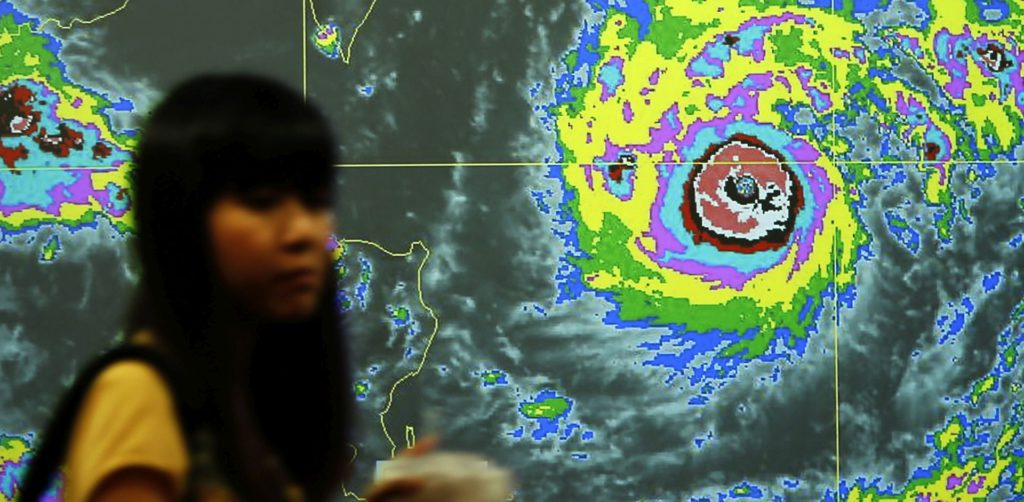 epa05409913 A Taiwanese walks past a video screen with the graph of Typhoon Nepartak heading towards Taiwan, inside the central weather bureau in Taipei, Taiwan, 06 July 2016. Taiwan Central Weather Bureau issued a sea warning for Typhoon Nepartak as it approaches towards southern and eastern Taiwan. Nepartak was centered 870 kilometers southeast of Hualien on Taiwan's east coast. Nepartak was estimated of a radius of 200 kilometers, moving at 320 kilometers per hour, with maximum sustained winds of 198 kilometers per hour and gusts of up to 245 kilometers per hour. EPA/RITCHIE B. TONGO